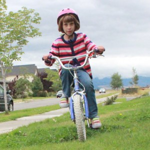 This child didn't walk til she was over 2 years old, yet here at 7 she's riding a 2 wheel bike like a boss