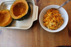 Scooping out winter squash seeds
