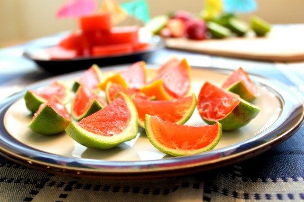 Strawberry margarita jello shots in lime rinds