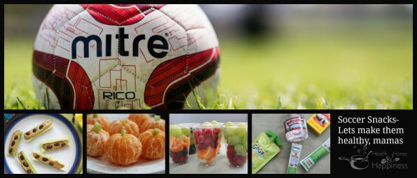 a soccer game and soccer snacks of celery with peanutbutter, peeled clemintine oranges 'pumpkins' with little stems of cut celery, clear cups filled with fresh fruit, and packaged raisins applesauce string cheese and water