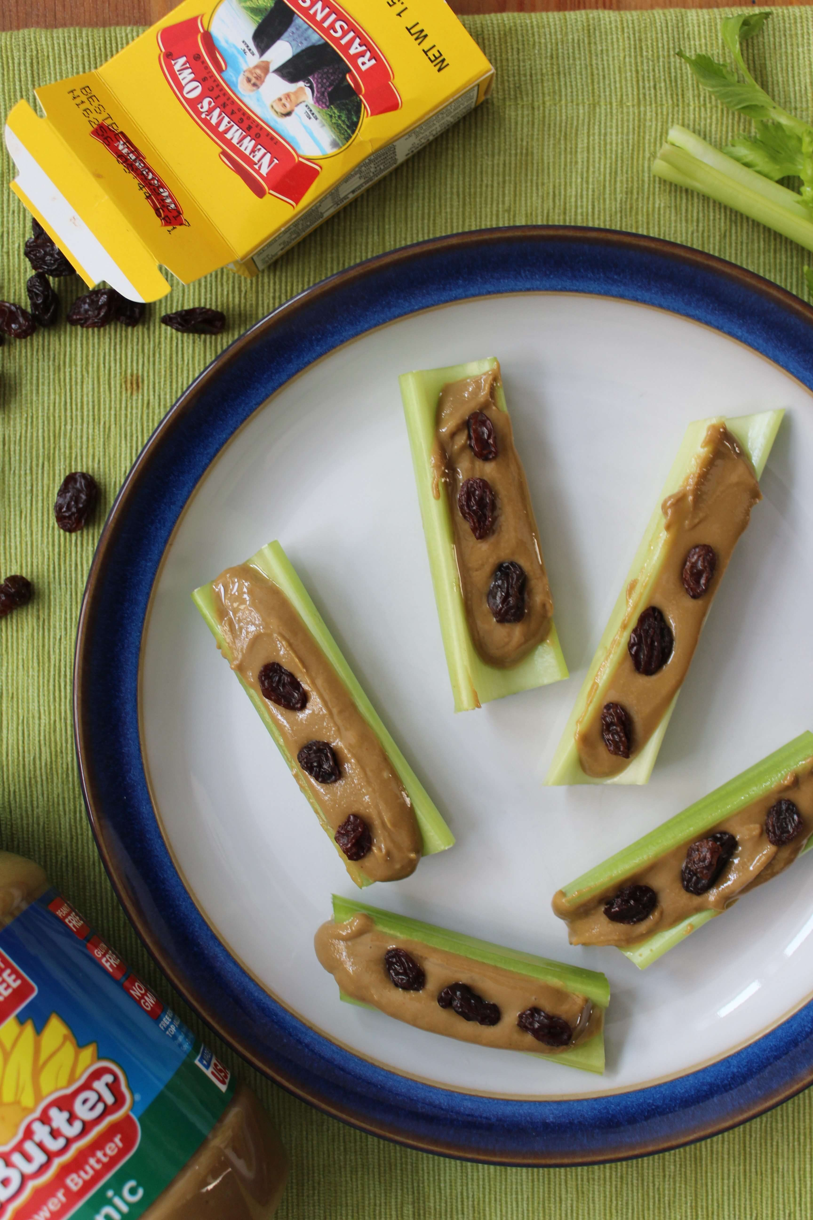 healthy soccer snacks of raisin boxes and ants on a log made with sunbutter
