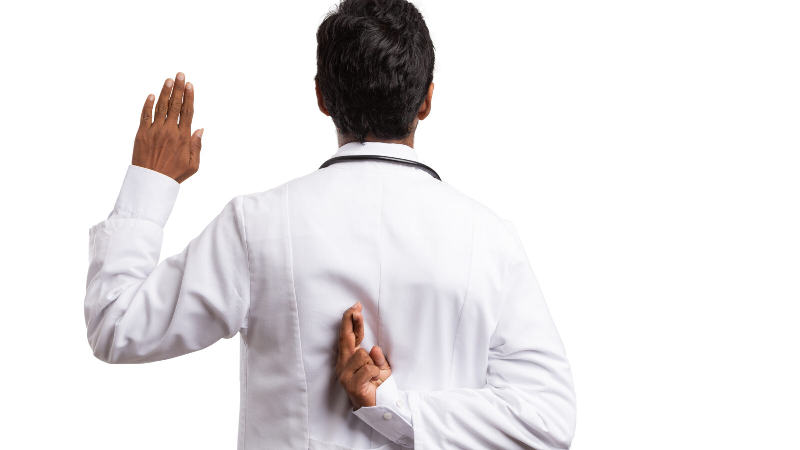 Doctor taking an oath with fingers crossed behind his back