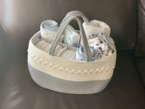 Basket filled with newborn essentials to keep in the living room to help minimize going up and down stairs